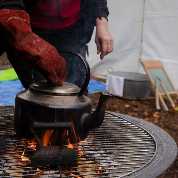 hot kettle on lit camp fire
